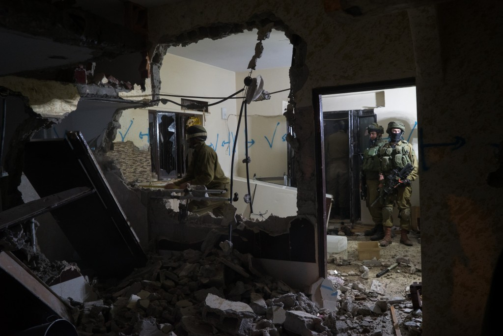 "Israeli soldiers demolish internal walls at the home of Ihab Maswadeh in the West Bank city of Hebron March 31, 2016. Ihab who was shot dead by Israeli troops after stabbing to death Gennady Kaufman, 41, near the Ibrahimi mosque on December 7, 2015. Photo by IDF Spokesperson *** Local Caption *** äøéñú áéú äøñ äøåñ áéú ôìñèéðéí çáøåï äâãä äîòøáéú îçáì èøåø ôéâåò òåðù îùôçä çééìéí öä""ì äøñ"
