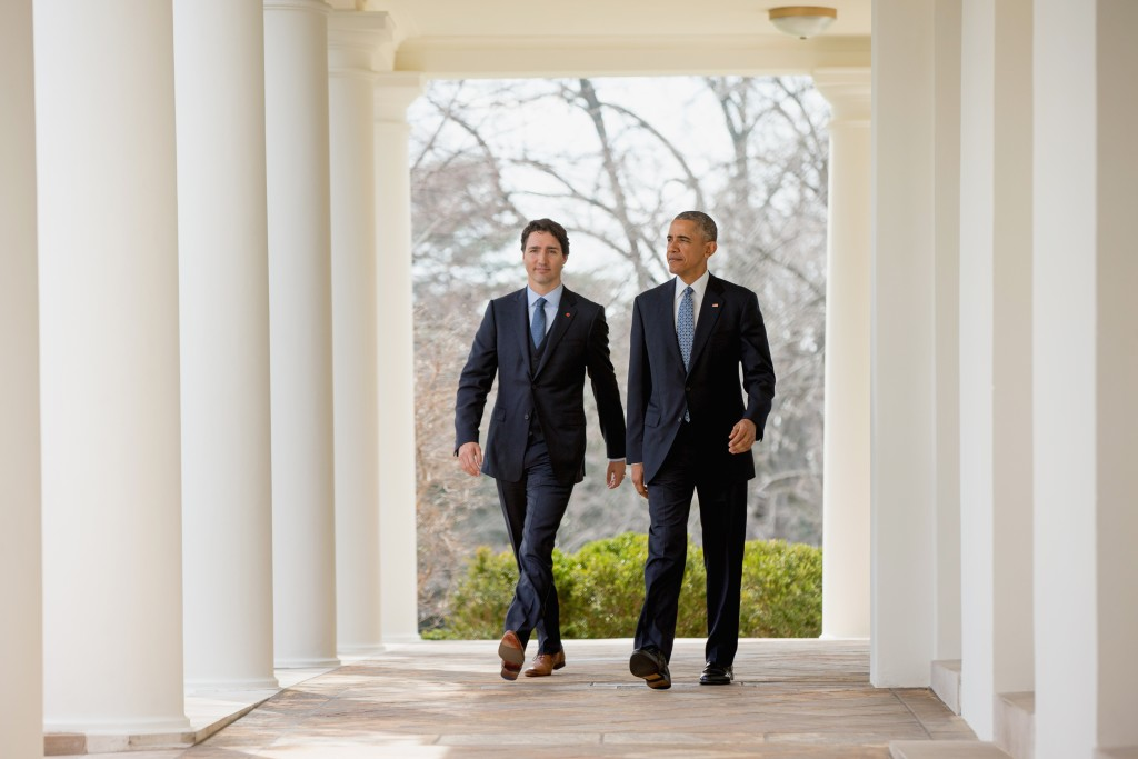 President Barack Obama and Canadian Prime Minister Justin Trudeau walks through the colonnade to speak at a bilateral news conference in the Rose Garden of the White House in Washington, Thursday. (AP Photo/Andrew Harnik)
