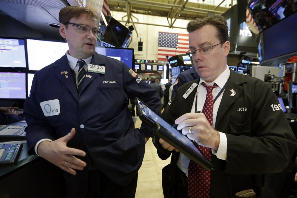 Specialist Peter King, left, and trader Joseph Murray work on the floor of the New York Stock Exchange on Monday. (AP Photo/Richard Drew)