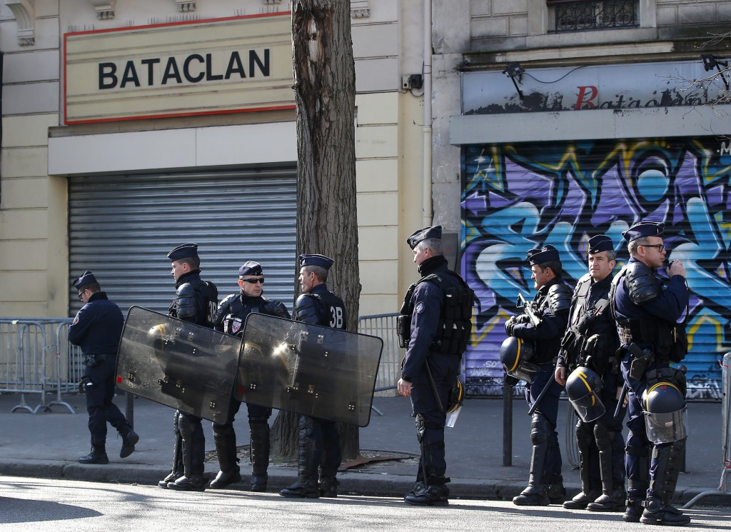 Riot police officers guard the Bataclan concert hall in Paris, Thursday, March 17, 2016. French lawmakers leading an investigation into the Nov. 13 attacks and some of the first responders at the Bataclan concert hall that night returned Thursday to re-enact the horror that left a total of 130 people dead across Paris. (AP Photo/Michel Euler)