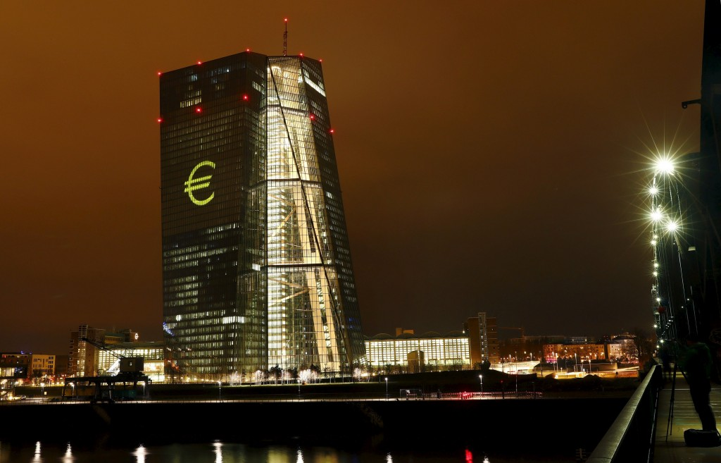 """The head quarter of the European Central Bank (ECB) is illuminated with a giant euro sign at the start of the """"Luminale, light and building"""" event in Frankfurt, Germany, March 12, 2016. REUTERS/Kai Pfaffenbach"""