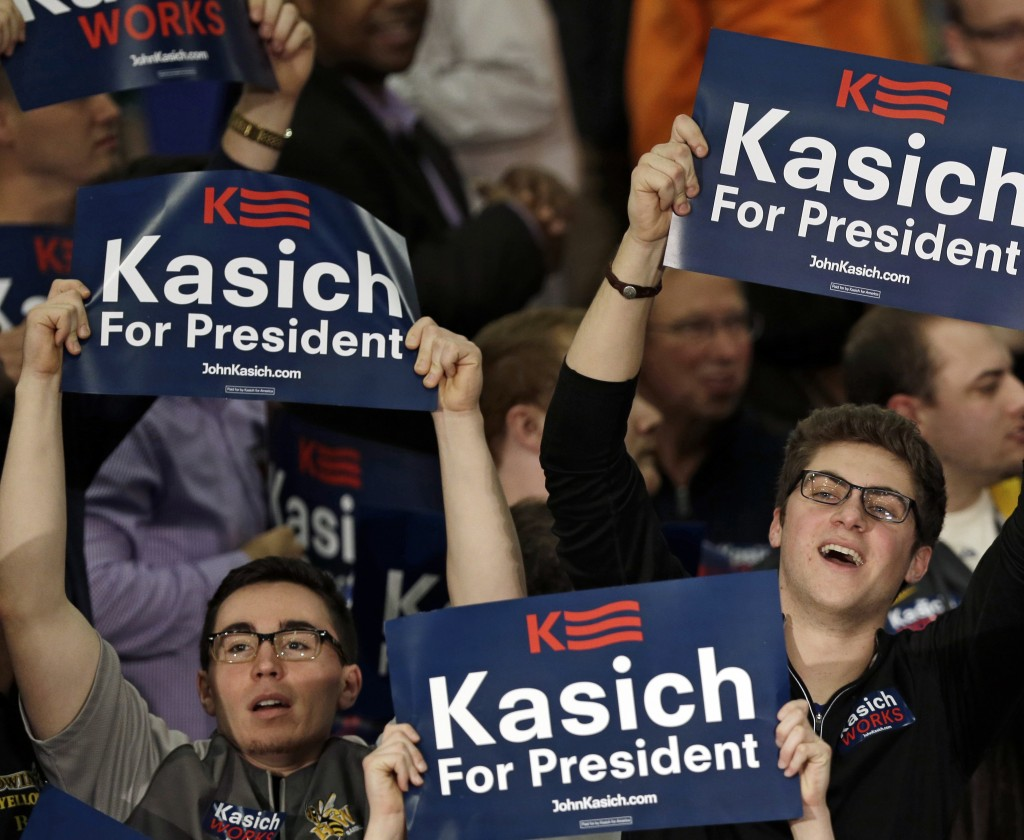 Supporters cheer for Republican presidential candidate, Ohio Gov. John Kasich before he speaks at his presidential primary election night rally in Berea, Ohio, on Tuesday, March 15, 2016. Kasich won the Ohio primary. (AP Photo/Tony Dejak)