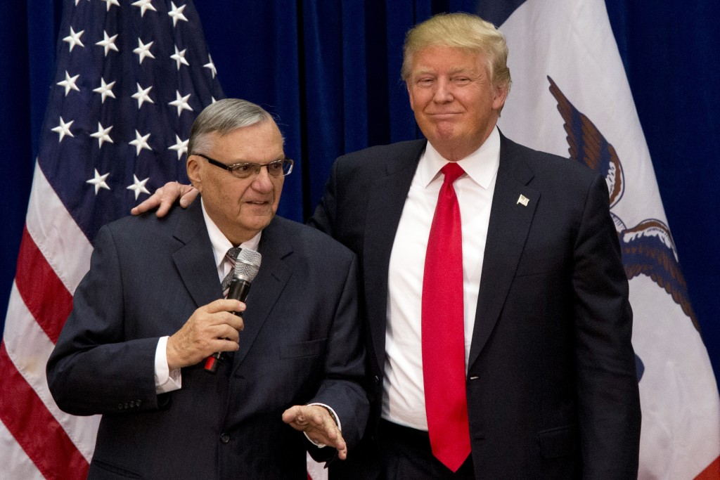 In this Jan. 26, 2016, photo, Republican presidential candidate Donald Trump is joined by Maricopa County, Ariz., Sheriff Joe Arpaio as a campaign event at the Roundhouse Gymnasium in Marshalltown, Iowa. Before Trump, there was Arpaio roiling Arizona politics and the nation's immigration debate. Trump hopes to win Arizona's primary Tuesday with the help of his fellow immigration hardliner (AP Photo/Mary Altaffer, File)
