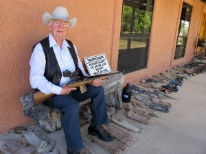 Jim Chilton on the front porch of his home on his 50,000 acre ranch along the U.S-Mexico border in in Arivaca, Ariz. (AP Photo/Brian Skoloff)