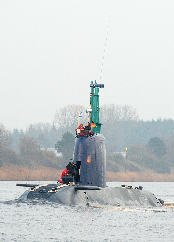 "FILE - In this Dev, 17, 2015 file picture Israeli navy submarine ""Rahav"" travels along the Kiel-Canal that links the  Baltic  Sea  with the North Sea  near Rendsburg,  northern Germany.  Summary: Two Israeli security agents had their cover blown by a suspicious retiree after their car became stuck in the mud in northern Germany. Police in Neumuenster were alerted Dec. 17 to ""suspicious people near the canal"" by the mayor of nearby Quarnbek, who had received a call from an elderly female resident.The agents were there to monitor the delivery of a new German-built submarine bought by Israel.   (Daniel Bockwoldt/dpa via AP,file)"