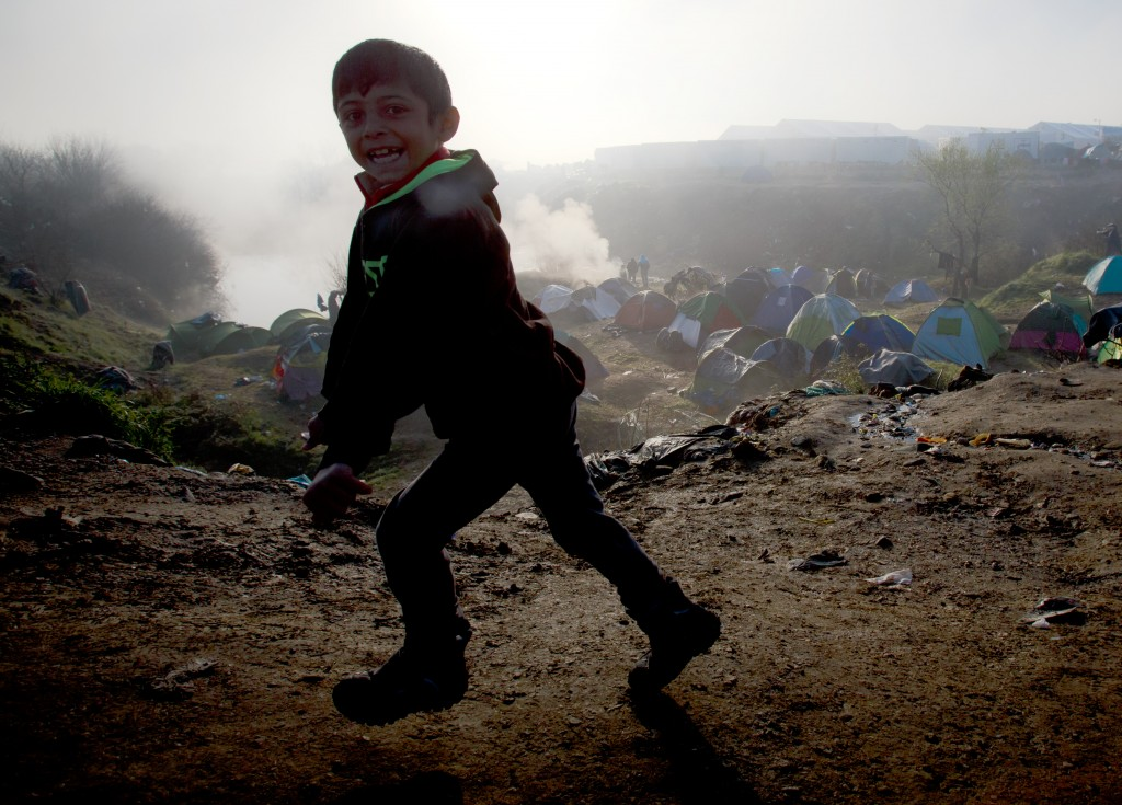 A child runs on a foggy morning at the northern Greek border station of Idomeni, Friday, March 11, 2016. After nearly three days of rain, conditions in the refugee camp on the Greek-Macedonian where about 14,000 people are stranded have deteriorated significantly, with many of its residents struggling to re-pitch their small camping tents in slightly drier patches.(AP Photo/Vadim Ghirda)