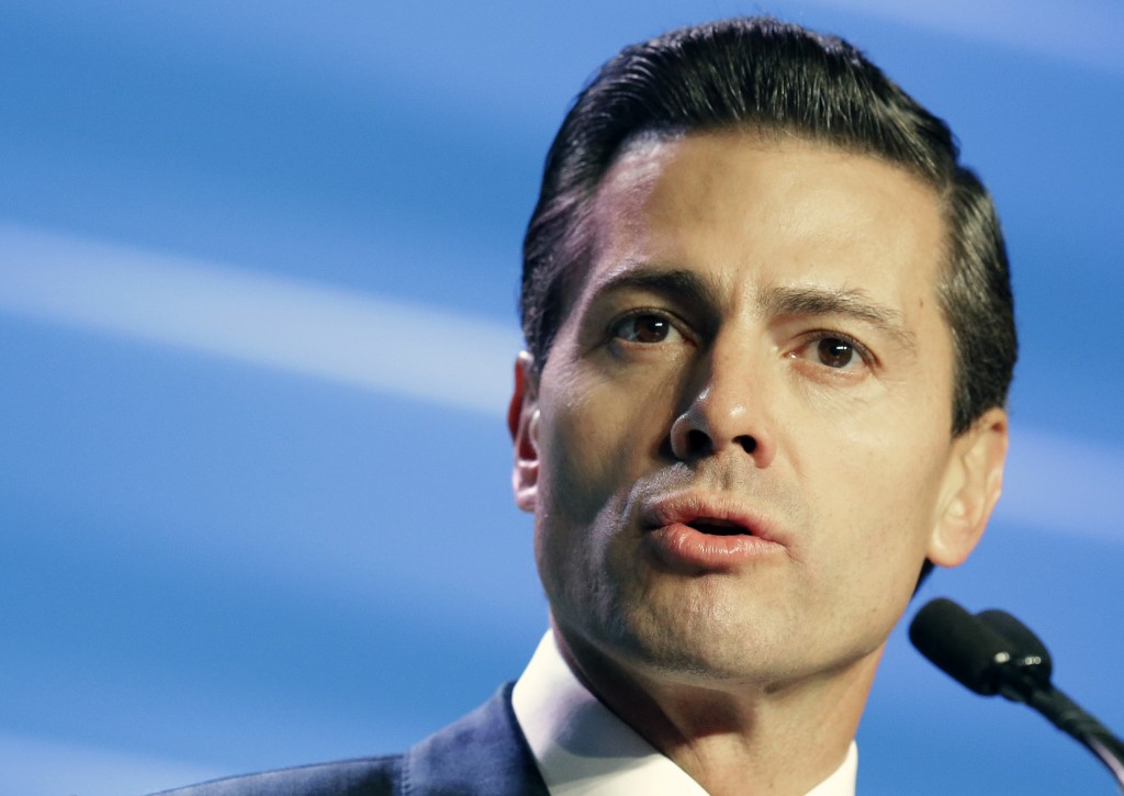 Mexican President Enrique Peña Nieto gives the opening address to attendees of the annual IHS CERAWeek global energy conference Monday, Feb. 22, 2016, in Houston. (AP Photo/Pat Sullivan)