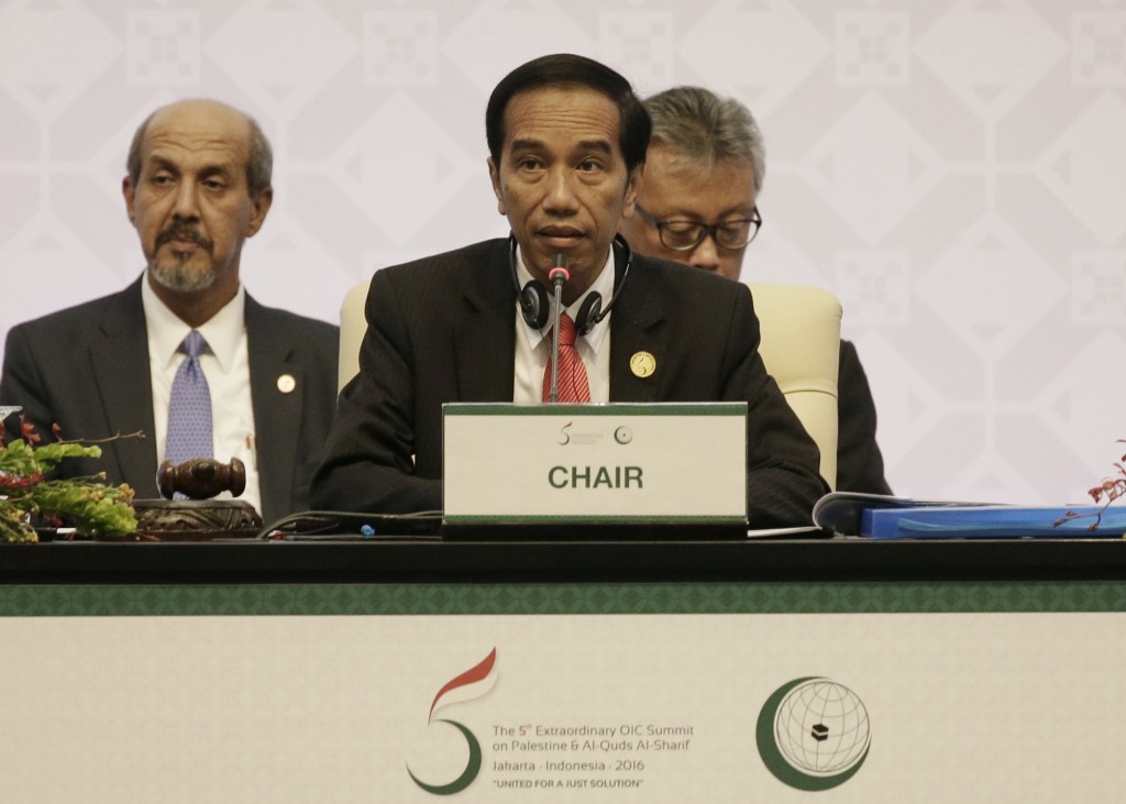 Indonesian President Widodo, center, speaks during the plenary session of the extraordinary Organization of Islamic Cooperation (OIC) summit on Palestinian issues in Jakarta, Indonesia, Monday. (AP Photo/Achmad Ibrahim, Pool)