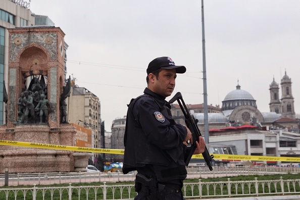 A Turkish police officer stands guard in central Taksim square following a suicide bombing in a major shopping and tourist district in the central part of Istanbul, Turkey. (Photo by Burak Kara/Getty Images)