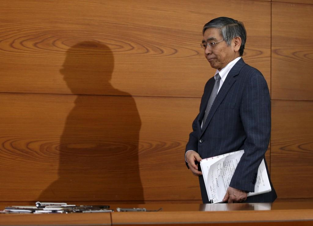 Bank of Japan (BOJ) Governor Haruhiko Kuroda arrives at a news conference at the BOJ headquarters in Tokyo, Japan, March 15, 2016. REUTERS/Toru Hanai