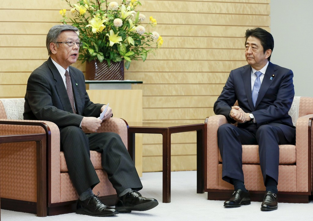 Okinawa Governor Takeshi Onaga (L) talks with Japanese Prime Minister Shinzo Abe during their meeting at Abe's official residence in Tokyo, Japan, March 4, 2016. REUTERS/Kimimasa Mayama/Pool