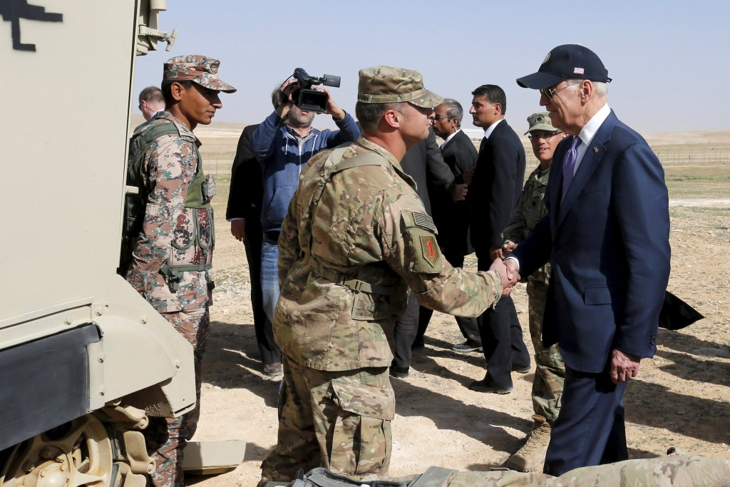 U.S. Vice President Joe Biden (R) visits a joint Jordanian-American training center at Zarqa, northeast of Amman, Jordan, March 10, 2016. REUTERS/Muhammad Hamed