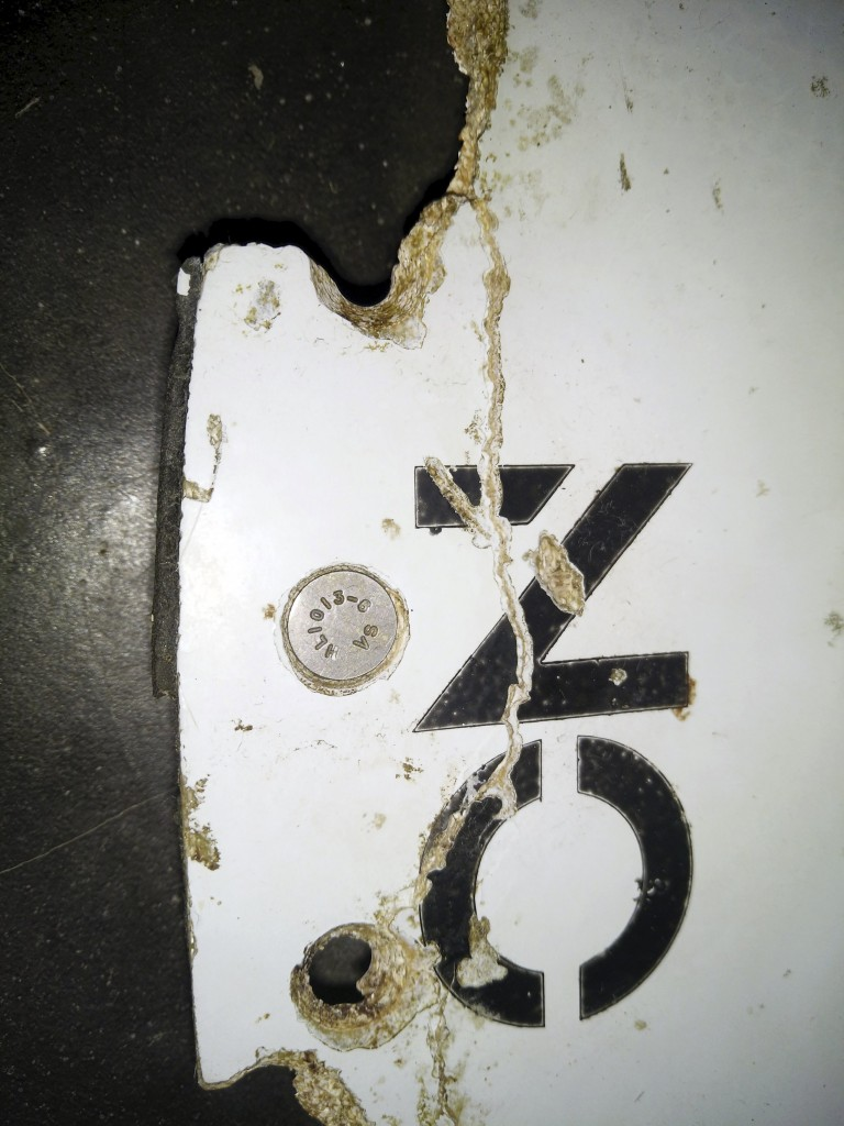 A photograph of debris thought to be from the missing Malaysian Airlines MH370 plane is seen in this handout picture taken on February 28, 2016. REUTERS/Blaine Gibson/Australian Transport Safety Bureau/Handout via Reuters ATTENTION EDITORS - THIS IMAGE WAS PROVIDED BY A THIRD PARTY. REUTERS IS UNABLE TO INDEPENDENTLY VERIFY THE AUTHENTICITY, CONTENT, LOCATION OR DATE OF THIS IMAGE. IT IS DISTRIBUTED EXACTLY AS RECEIVED BY REUTERS, AS A SERVICE TO CLIENTS. FOR EDITORIAL USE ONLY. NOT FOR SALE FOR MARKETING OR ADVERTISING CAMPAIGNS. NO RESALES. NO ARCHIVE. MANDATORY CREDIT. TPX IMAGES OF THE DAY