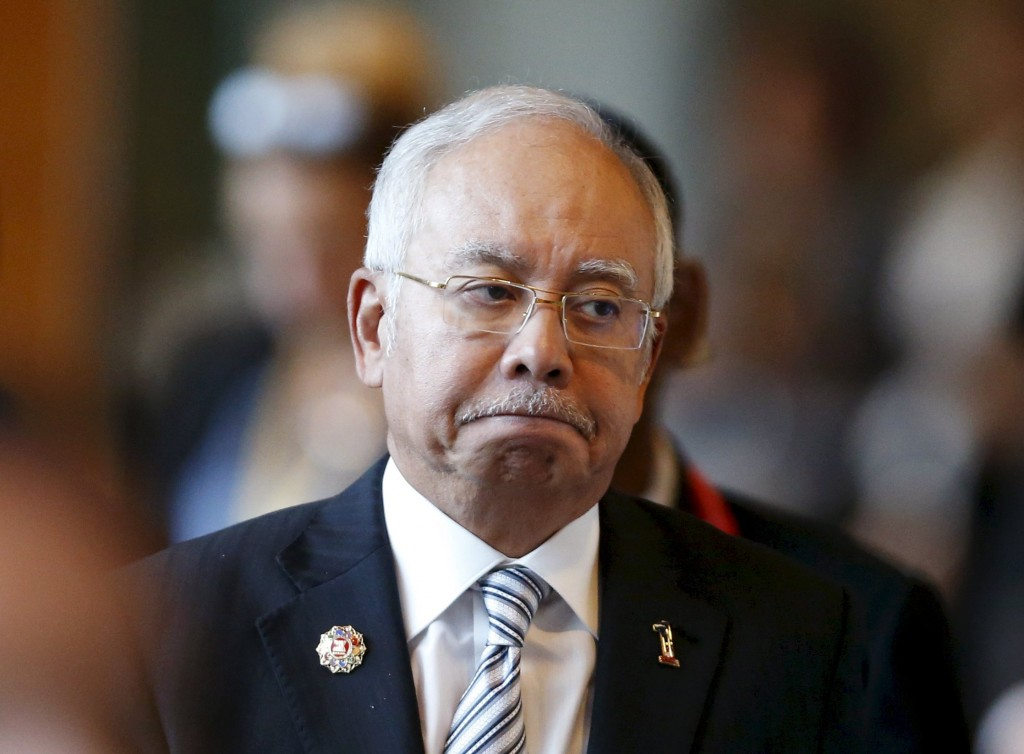 Malaysia's Prime Minister Najib Razak arrives at a session of the 27th Association of Southeast Asian Nations (ASEAN) Summit in Kuala Lumpur, in this November 21, 2015 file photo. Deposits into Najib's bank accounts ran to hundreds of millions of dollars more than previously identified by probes into state fund 1Malaysia Development Berhad, the Wall Street Journal reported on February 29, 2016. REUTERS/Olivia Harris/Files