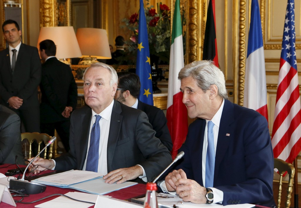French Foreign Minister Jean-Marc Ayrault (L) and U.S. Secretary of State John Kerry attend a meeting over the crisis in the Mideast, at the Quai d'Orsay ministry in Paris, France, March 13, 2016. REUTERS/Gonzalo Fuentes