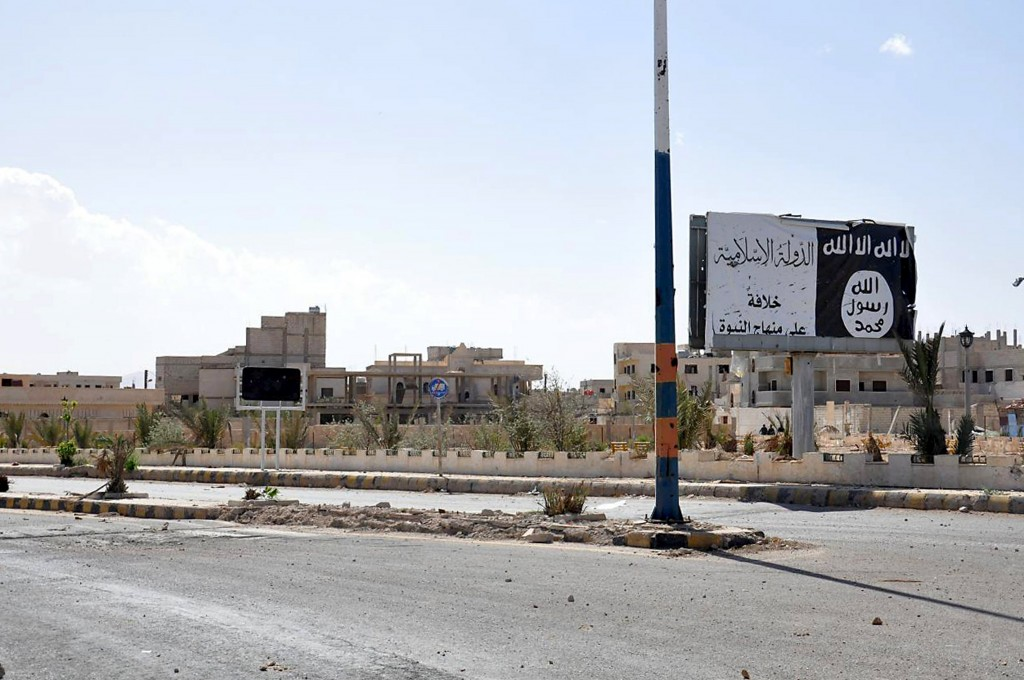 A billboard (R) belonging to the Islamic State fighters erected along a road, is pictured after forces loyal to Syria's President Bashar al-Assad recaptured Palmyra city, in Homs Governorate in this handout picture provided by SANA on March 27, 2016. REUTERS/SANA/Handout via Reuters ATTENTION EDITORS - THIS PICTURE WAS PROVIDED BY A THIRD PARTY. REUTERS IS UNABLE TO INDEPENDENTLY VERIFY THE AUTHENTICITY, CONTENT, LOCATION OR DATE OF THIS IMAGE. FOR EDITORIAL USE ONLY. NOT FOR SALE FOR MARKETING OR ADVERTISING CAMPAIGNS. THIS PICTURE IS DISTRIBUTED EXACTLY AS RECEIVED BY REUTERS, AS A SERVICE TO CLIENTS