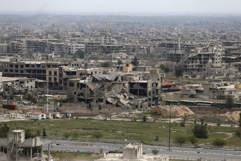 A general view shows damaged buildings as seen from the rebel held Qaboun neighborhood of Damascus, Syria March 13, 2016. Picture taken March 13, 2016. REUTERS/Bassam Khabieh