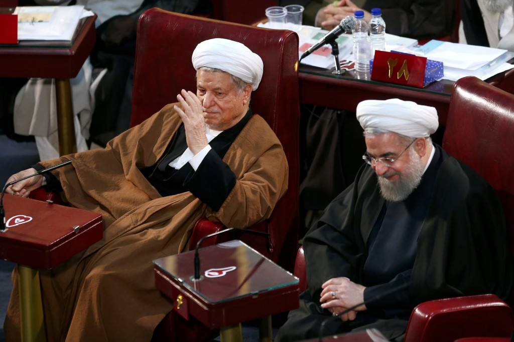 Iranian President Hassan Rouhani, right, and former President Akbar Hashemi Rafsanjani, left, who are members of the Assembly of Experts, attend the last seasonal meeting of the fourth assembly in Tehran, Iran, Tuesday, March 8, 2016. The next Assembly of Experts meeting will be held on late May by the new Experts who have won the recent elections. (AP Photo/Ebrahim Noroozi)