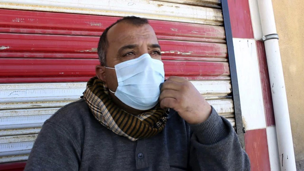In this Friday, March 11, 2016 photo, a man exposed to a chemical attack sits outside a hospital as he waits for treatment in Taza, 10 miles (20 kilometers) south of Kirkuk in northern Iraq. The Islamic State group launched two chemical attacks near the northern Iraqi city of Kirkuk, killing a three-year-old girl, wounding some 600 people and causing hundreds more to flee, Iraqi officials said Saturday. (AP Photo)