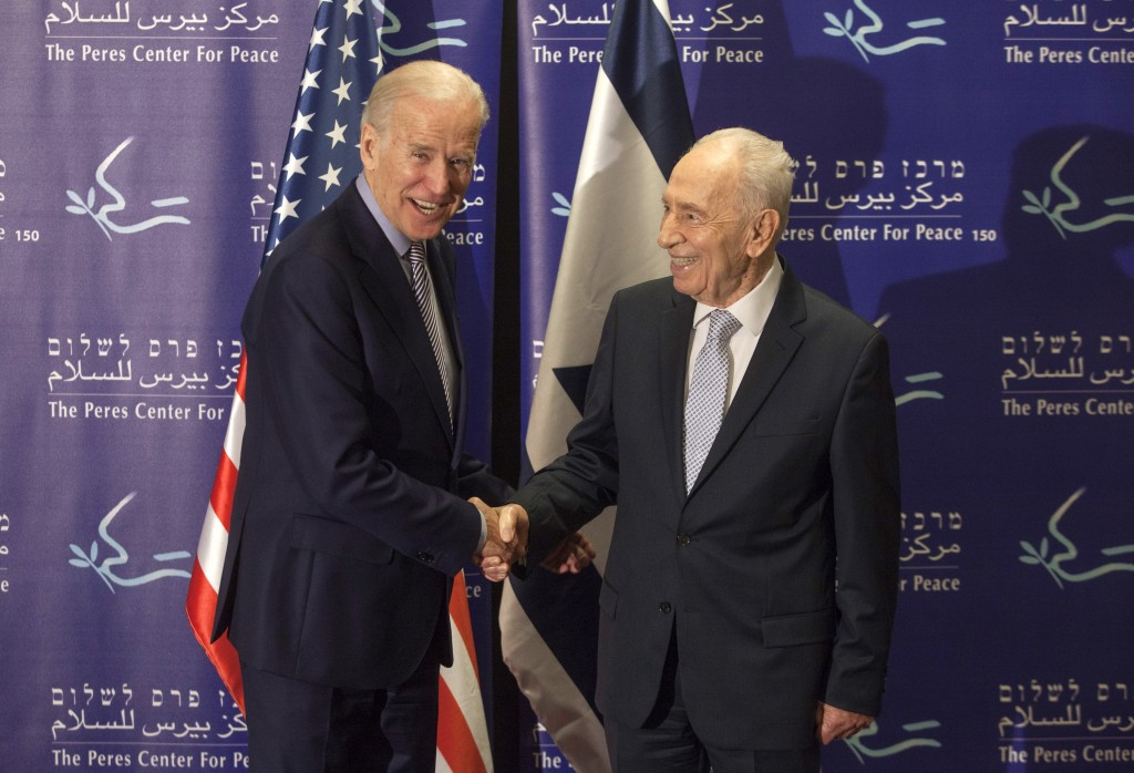 Former Israeli President Shimon Peres, right, and U.S. Vice President Joe Biden at the Peres Center for Peace in Jaffa on Tuesday. (AP Photo/Dan Balilty)