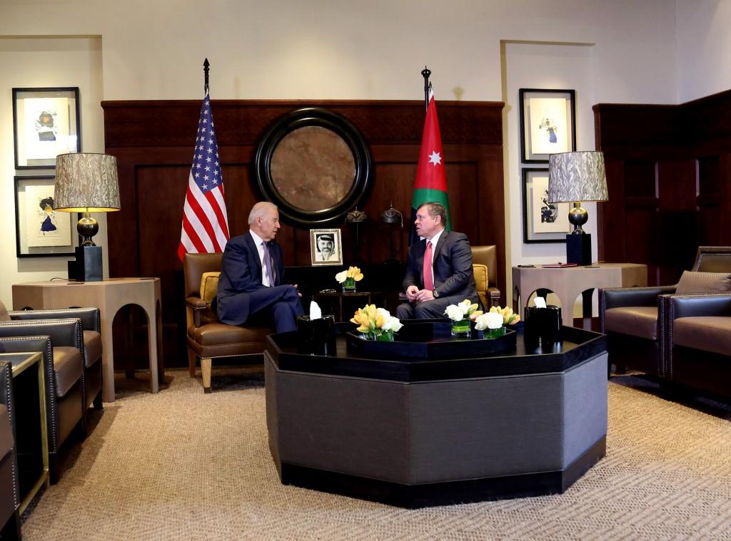King Abdullah II of Jordan, right, meets with US Vice President Joe Biden, at the Husseiniya Palace in Amman, Jordan, Thursday, March 10, 2016. (AP Photo/Raad Adayleh)