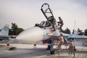 In this file photo from October, Russian air force pilots assisted by ground crew climb into their fighter jet at Hemeimeem airbase, Syria. (AP Photo/Vladimir Isachenkov, File)