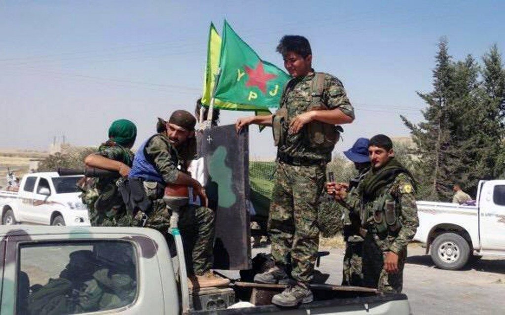 Kurdish fighters of the YPG are seen in Ein Eissa, north of Raqqa, Syria, in this June 2015 photo. (The Kurdish fighters of the People's Protection Units via AP, File)