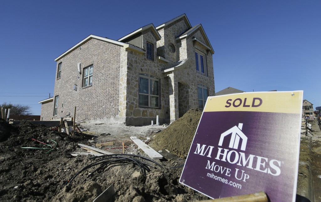 A house under the final stages of construction in Plano, Texas. (AP Photo/LM Otero)