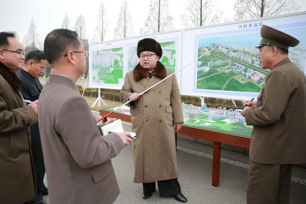 North Korean leader Kim Jong Un (C) speaks at an event declaring the construction of Ryomyong Street, in this photo released by North Korea's Korean Central News Agency (KCNA) in Pyongyang on March 18, 2016.        REUTERS/KCNA          ATTENTION EDITORS - THIS PICTURE WAS PROVIDED BY A THIRD PARTY. REUTERS IS UNABLE TO INDEPENDENTLY VERIFY THE AUTHENTICITY, CONTENT, LOCATION OR DATE OF THIS IMAGE. FOR EDITORIAL USE ONLY. NOT FOR SALE FOR MARKETING OR ADVERTISING CAMPAIGNS. NO THIRD PARTY SALES. NOT FOR USE BY REUTERS THIRD PARTY DISTRIBUTORS. SOUTH KOREA OUT. NO COMMERCIAL OR EDITORIAL SALES IN SOUTH KOREA. THIS PICTURE IS DISTRIBUTED EXACTLY AS RECEIVED BY REUTERS, AS A SERVICE TO CLIENTS.