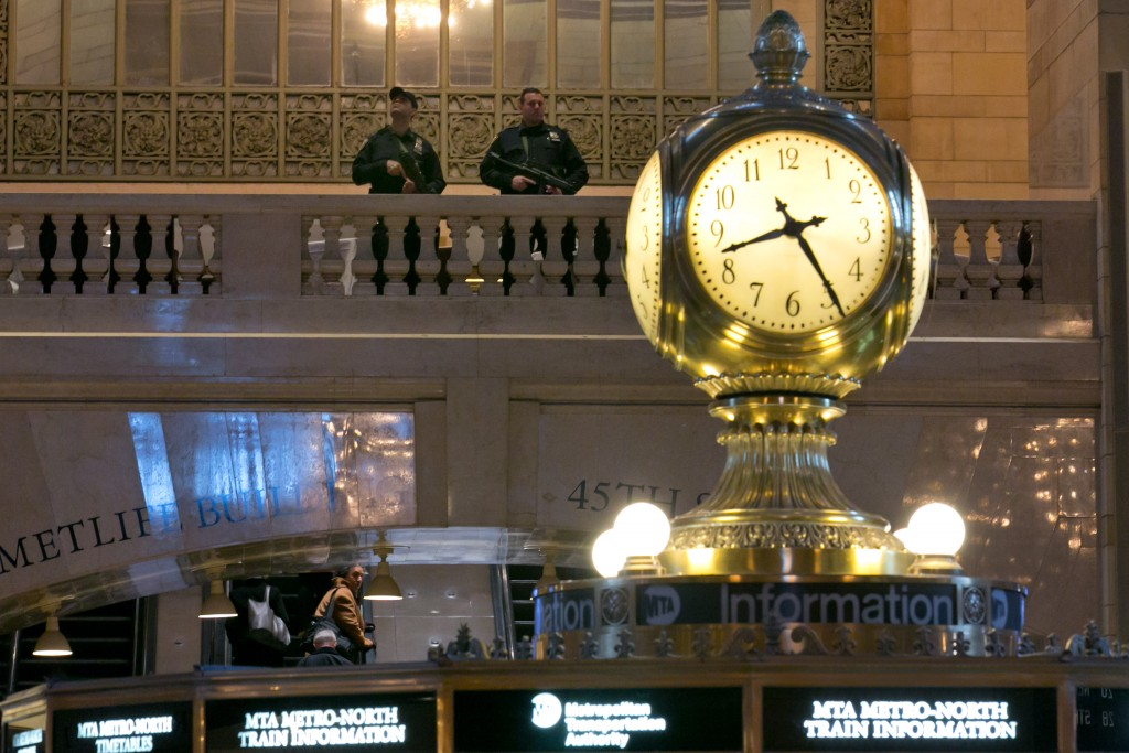 A pair of Metro-North Railroad Police officers patrol in New York's Grand Central Terminal on Tuesday. (AP Photo/Richard Drew)