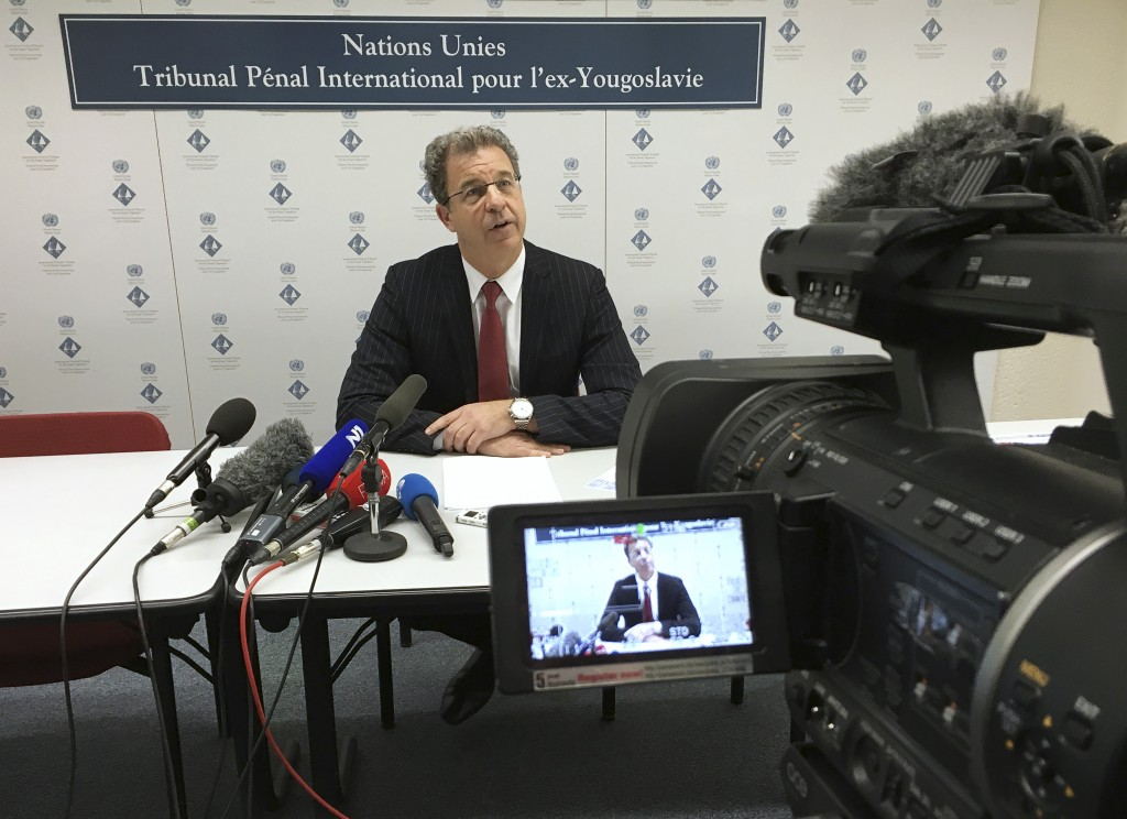 Serge Brammertz, Chief Prosecutor of the Yugoslav war crimes tribunal speaks during a press conference in The Hague, Netherlands, Thursday March 31, 2016. In a sweeping defeat for U.N. prosecutors, the Yugoslav war crimes tribunal acquitted Serbian ultranationalist politician Vojislav Seselj on Thursday of all nine counts alleging that he was responsible for, or incited, atrocities by Serbian paramilitaries in the wars in Bosnia and Croatia in the early 1990's. (AP Photo/Alexander Furtula)