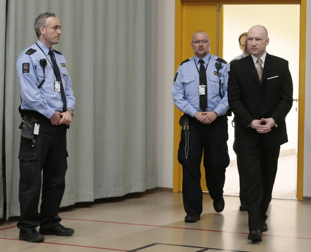 Anders Behring Breivik is escorted by prison guards as he enters a court room in Skien, Norway, on Tuesday, March 15, 2016. Breivik, the right-wing extremist who killed 77 people in bomb and gun attacks in 2011 has arrived in court for his human rights case against the Norwegian government. (Lise Aserud, NTB scanpix via AP) NORWAY OUT