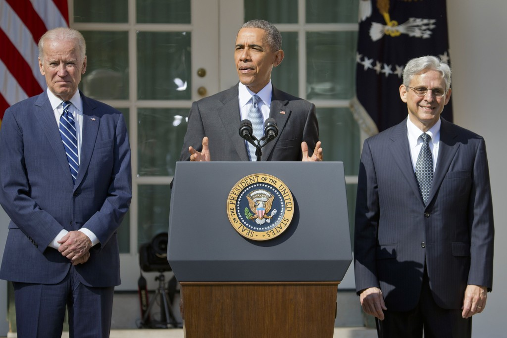 Federal appeals court judge Merrick Garland, right, stands with President Barack Obama and Vice President Joe Biden as he is introduced as Obama's nominee for the Supreme Court at the Rose Garden on Wednesday morning. (AP Photo/Pablo Martinez Monsivais)