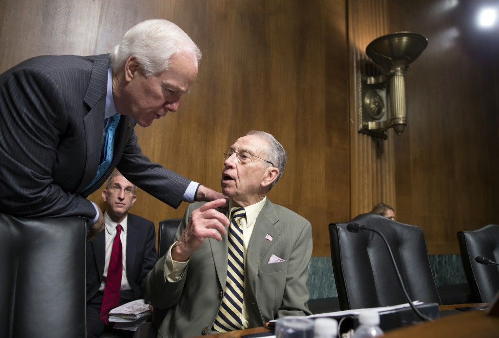 Sen. John Cornyn, R-Texas, the Senate majority whip, left, confers with Senate Judiciary Committee Chairman Chuck Grassley, R-Iowa, whose panel is responsible for vetting judicial appointments, at a hearing shortly after President Barack Obama announced Judge Merrick Garland as his nominee to replace the late Justice Antonin Scalia on the Supreme Court, on Capitol Hill in Washington, Wednesday, March 16, 2016. Senate Majority Leader Mitch McConnell, R-Ky., repeated his steadfast opposition to holding confirmation hearing in the Judiciary Committee in President Obama's last months in the White House and made it clear in a speech on the floor that the GOP-led Senate will not consider President Barack Obama's nominee, Merrick Garland, but will wait until after the next president is in place. (AP Photo/J. Scott Applewhite)
