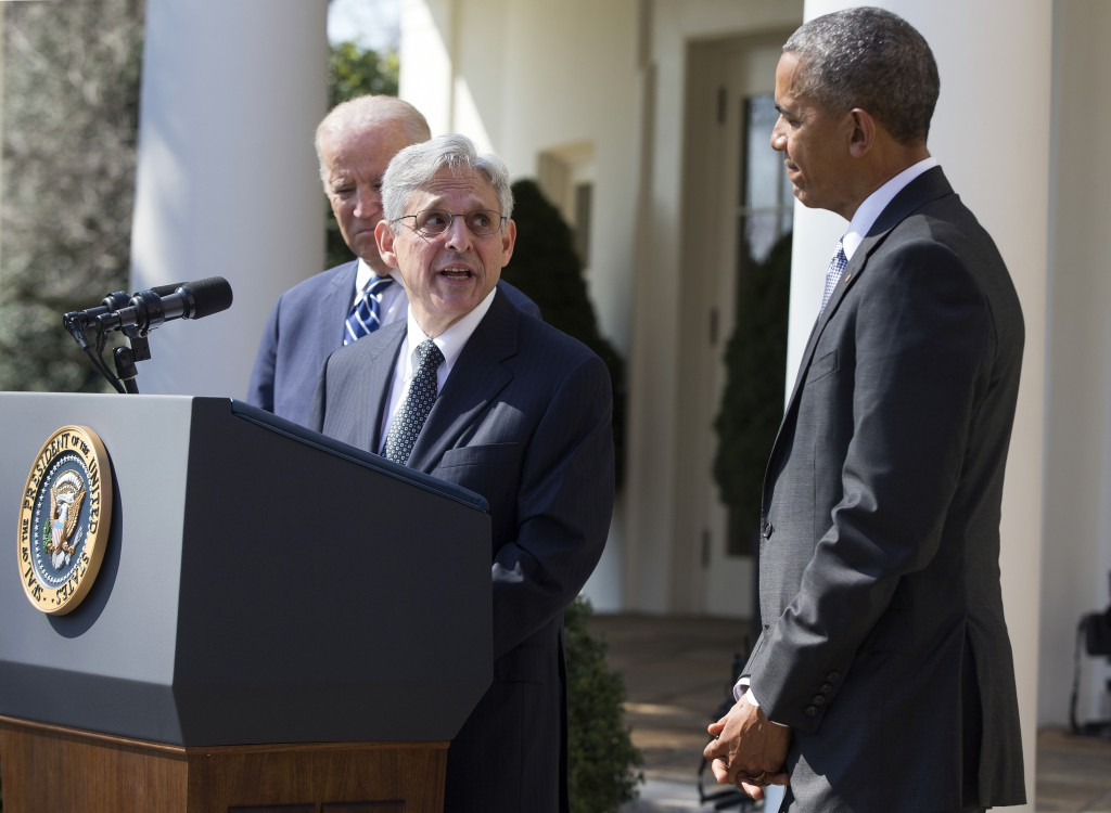 Federal appeals court judge Merrick Garland, center, speaks as President Barack Obama, right, and Vice President Joe Biden listen after he was introduced as Obama's nominee for the Supreme Court on Wednesday. (AP Photo/Evan Vucci)