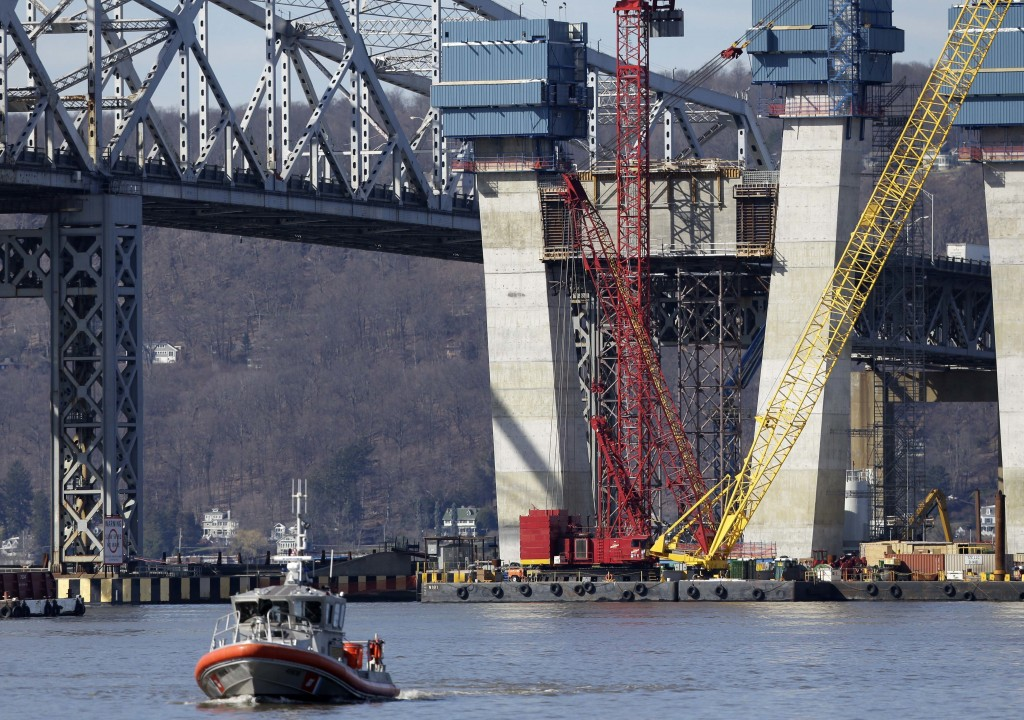 A Coast Guard boat passes near the site of a fatal collision in the water underneath the Tappan Zee Bridge in Tarrytown, N.Y., Saturday, March 12, 2016. A tugboat crashed into a barge on the Hudson River north of New York City early Saturday killing at least one crew member and leaving two still missing. (AP Photo/Seth Wenig)