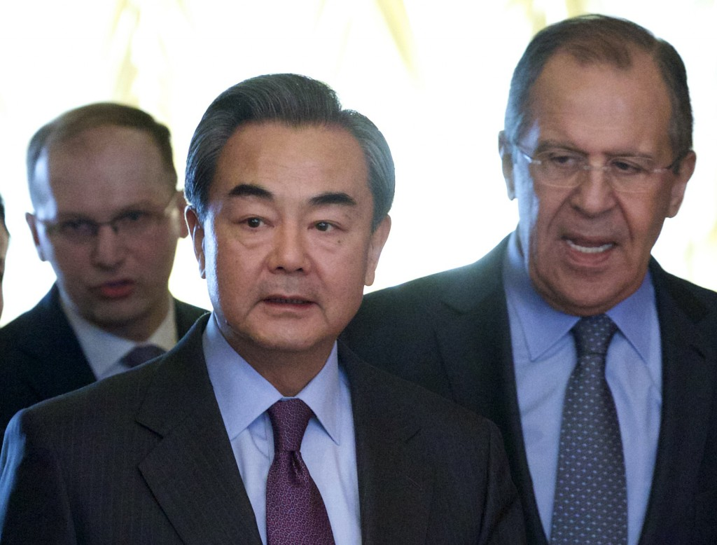 Russian Foreign Minister Sergey Lavrov, right, escorts Chinese counterpart Wang Yi as they walk for their meeting in Moscow, Russia, on Friday, March 11, 2016. (AP Photo/Ivan Sekretarev)