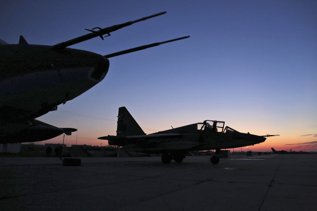 Russian Su-25 ground attack jets are parked after returning from Syria, at a Russian air base in Primorsko-Akhtarsk, southern Russia, Wednesday, March 16, 2016. More Russian planes returned from Syria on Wednesday, two days after President Vladimir Putin ordered Russian military to withdraw most of its fighting forces from Syria, signaling an end to Russia's five-and-a-half month air campaign.(Olga Balashova/Russian Defense Ministry Press Service via AP)