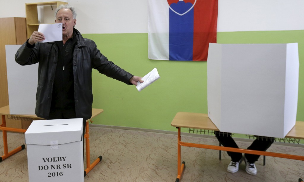 A voter reacts before casting his ballot at a polling station during the country's parliamentary election in Trnava, Slovakia, March 5, 2016. REUTERS/David W Cerny
