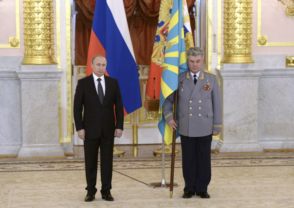 Russian President Vladimir Putin (L) and Russian Air Force Commander Viktor Bondarev attend an awarding ceremony for soldiers returning from Syria, at the Kremlin in Moscow, Russia, March 17, 2016. REUTERS/Alexei Nikolsky/Sputnik/Kremlin ATTENTION EDITORS - THIS IMAGE HAS BEEN SUPPLIED BY A THIRD PARTY. IT IS DISTRIBUTED, EXACTLY AS RECEIVED BY REUTERS, AS A SERVICE TO CLIENTS.