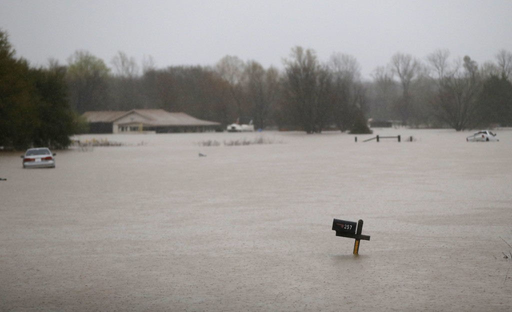 A mailbox, house and partially submerged cars are seen in rising floodwaters in Bossier Parish, La., Thursday, March 10, 2016. (AP Photo/Gerald Herbert)
