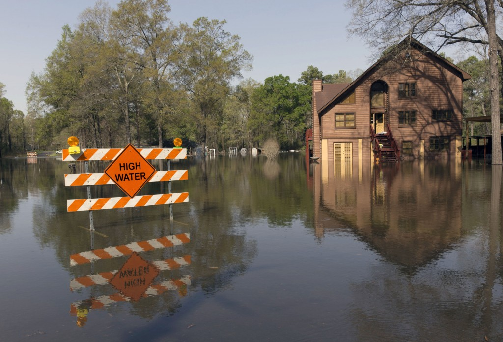 A sign marks high water in a flooded section of in Oil City, La., Sunday, March 13, 2016. President Barack Obama has signed an order declaring Louisiana's widespread flooding from heavy rains a major disaster. (Lee Celano/The Shreveport Times via AP) MAGS OUT; MANDATORY CREDIT SHREVEPORTTIMES.COM; NO SALES
