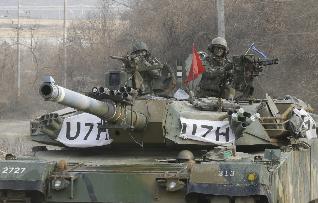 South Korean army soldiers ride a K-1 tank during an annual exercise in Yeoncheon, near the border with North Korea. (AP Photo/Ahn Young-joon)