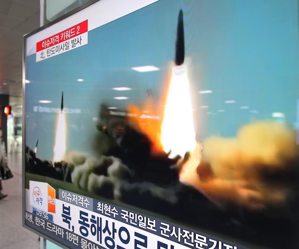 """A screen shows a file footage of the missile launch conducted by North Korea, at Seoul Railway Station in Seoul, South Korea, Thursday, March 10, 2016. North Korea fired two short-range ballistic missiles into the sea on Thursday, South Korea's military said, a likely show of anger at continuing springtime war games by rivals Washington and Seoul and another ratcheting up of hostility on the already anxious Korean Peninsula. The screen reads """"North Korea launched the missiles into East Sea."""" (AP Photo/Ahn Young-joon)"""