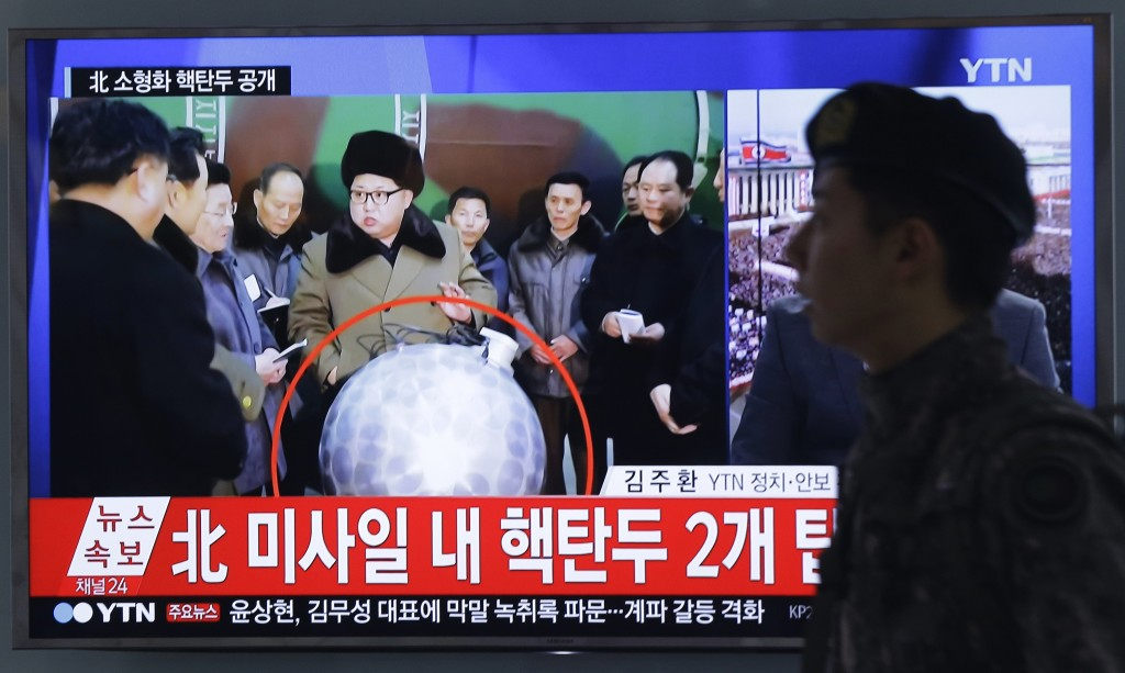 "A South Korean army soldier walks by a screen showing North Korean leader Kim Jong Un with superimposed letters that read: ""North Korea's nuclear warhead"" during a news program at Seoul Railway Station in Seoul, South Korea, Wednesday, March 9, 2016. The official North Korean news agency says the communist country's leader Kim met his nuclear scientists for a briefing and declared he was greatly pleased that warheads had been miniaturized for use on ballistic missiles. (AP Photo/Ahn Young-joon)"