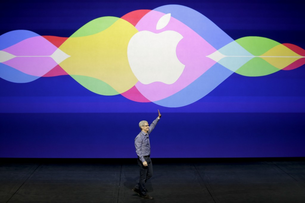 In this Sept. 9, 2015 photo, Apple CEO Tim Cook waves during an Apple event at the Bill Graham Civic Auditorium in San Francisco. (AP Photo/Eric Risberg, File)