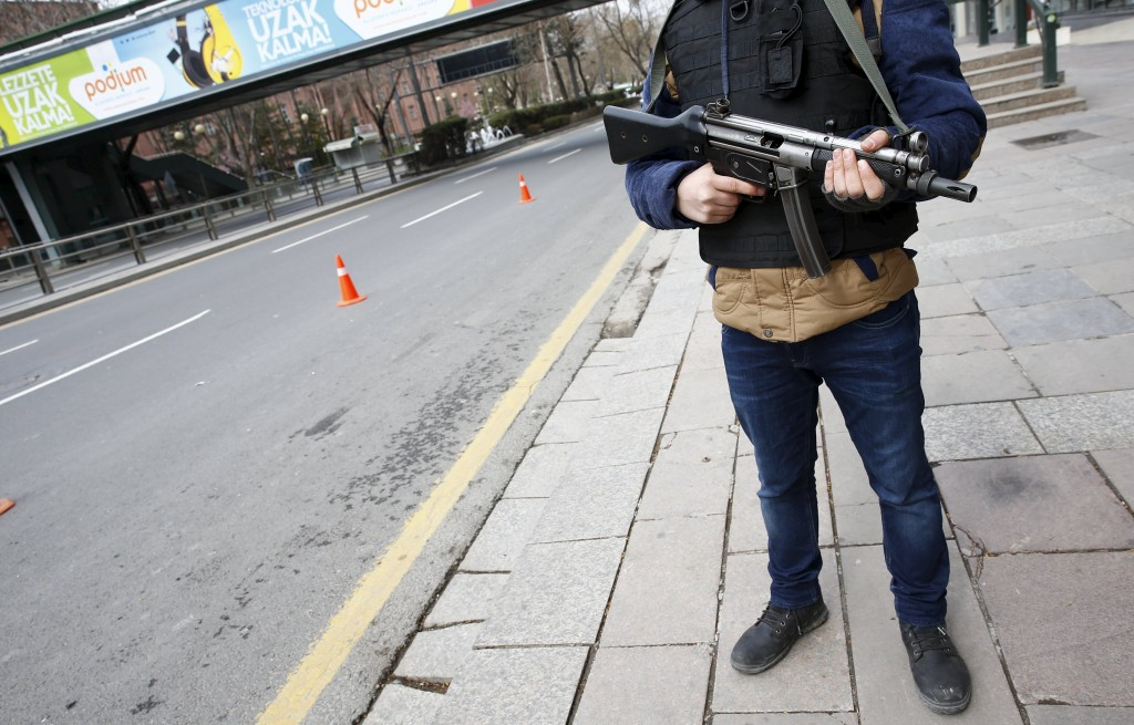 A police officer stands guard during a security control check in central Ankara, Turkey March 20, 2016. REUTERS/Umit Bektas