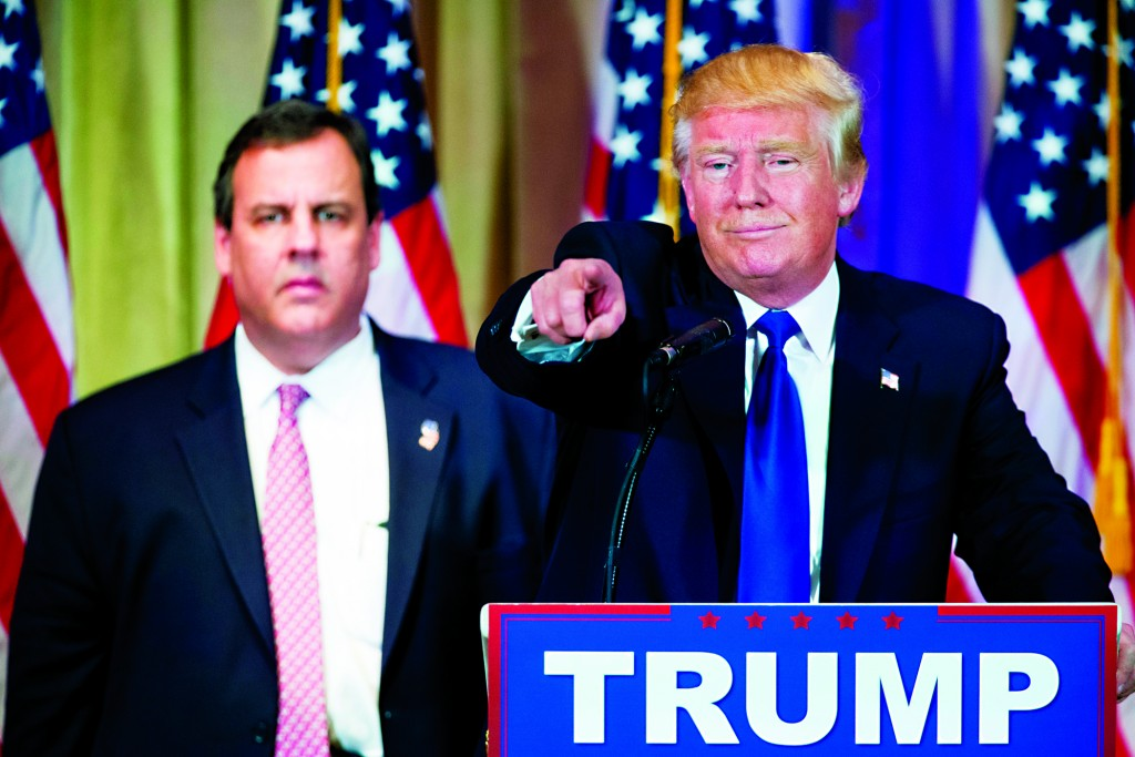 Donald Trump, accompanied by New Jersey Gov. Chris Christie (L), at a news conference on Super Tuesday in Palm Beach, Fla. (AP Photo/Andrew Harnik)