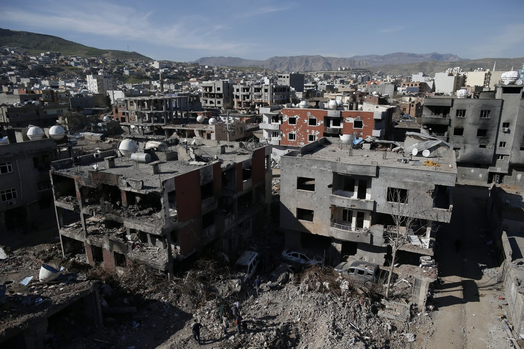 Ruined houses and buildings are seen in Cizre, Turkey, Wednesday, March 2, 2016. Turkish authorities on Wednesday scaled down a 24-hour curfew imposed on the mainly Kurdish town of Cizre in southeast Turkey, nearly three weeks after declaring the successful conclusion of military operations there. The stench of death and the smell of gunpowder rose from mounds of rubble Wednesday as residents of the Turkish town of Cizre returned to find many of their homes obliterated amid Turkey's efforts to crush Kurdish militants. At least one body was still lying inside a ruined house. (AP Photo/Emrah Gurel)