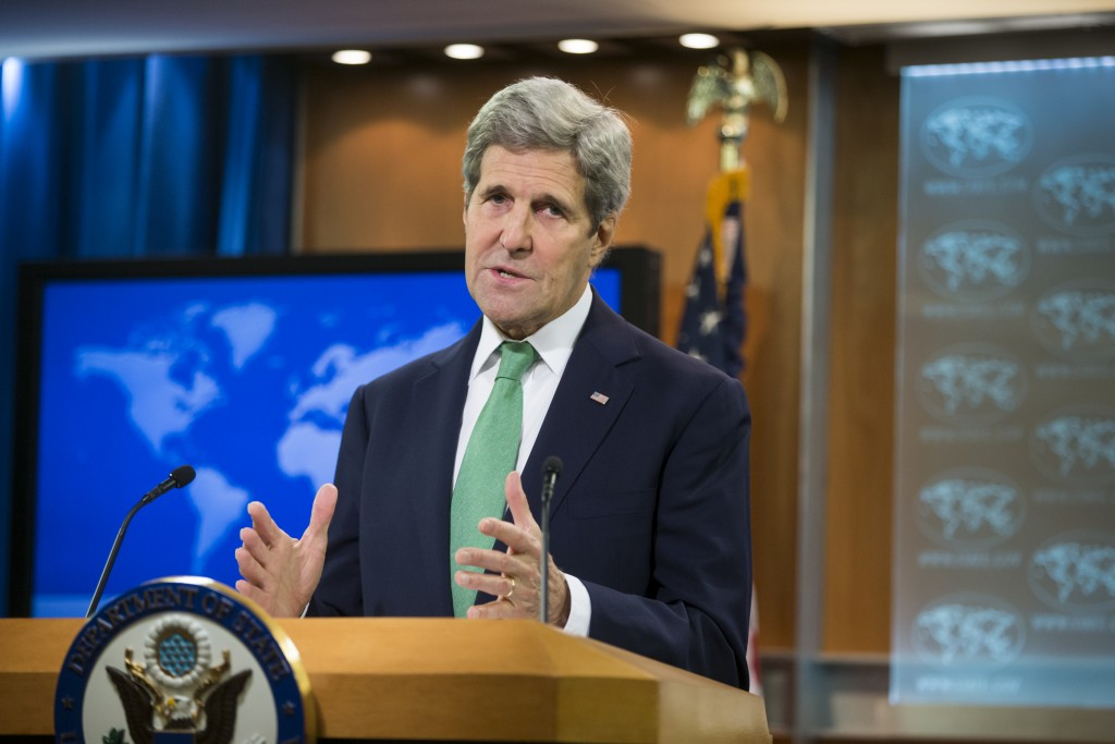 Secretary of State John Kerry speaks to reporters at the State Department in Washington, Thursday, March 17, 2016. Kerry has determined that the Islamic State group is committing genocide against Christians and other minorities in Iraq and Syria, as he acted to meet a congressional deadline. (AP Photo/J. Scott Applewhite)